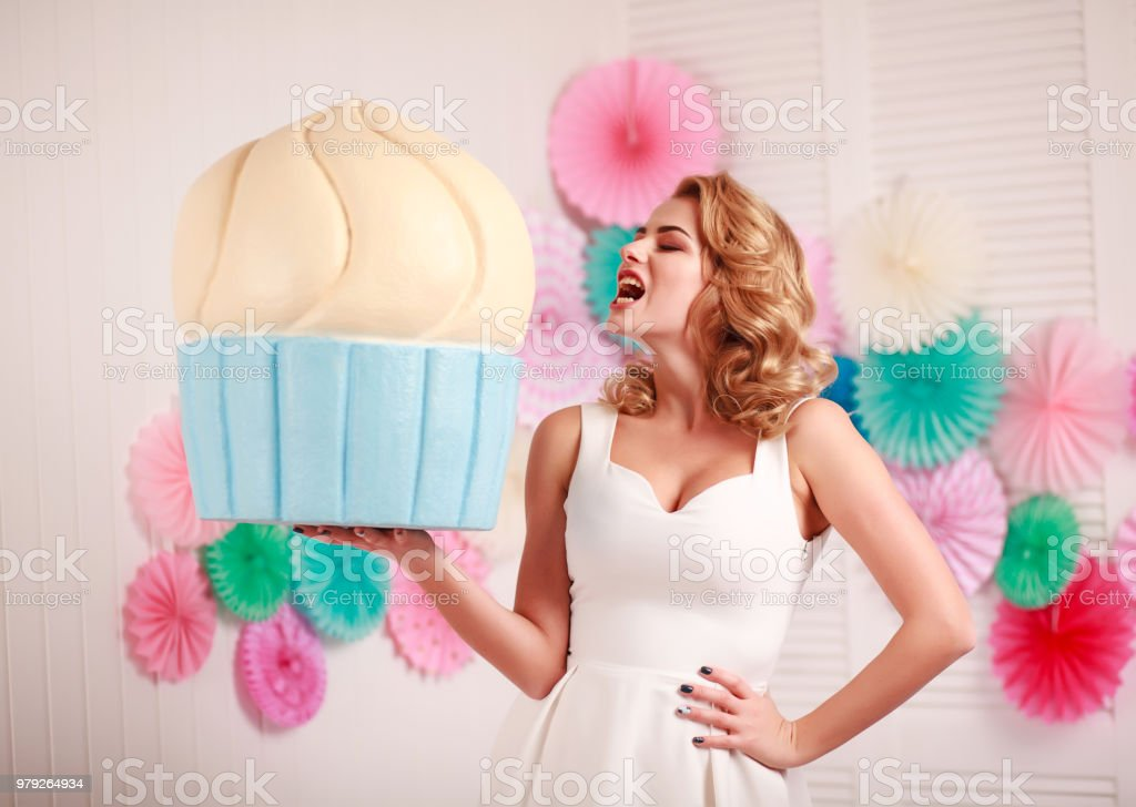 Woman with huge marshmallows and lollipop sweets dream stock photo