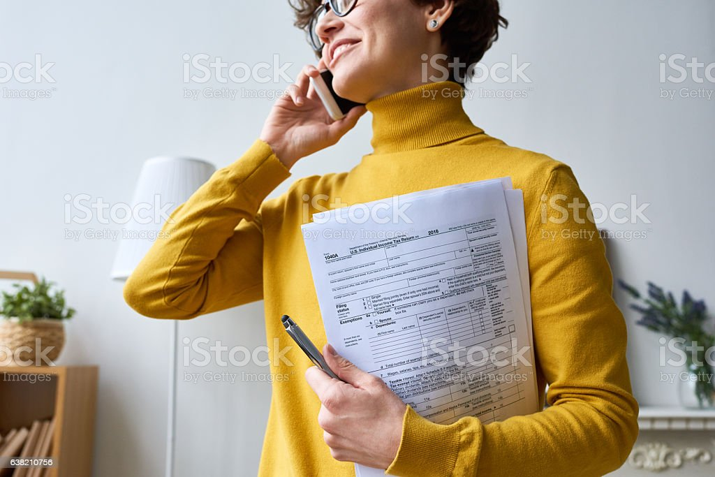 Woman with individual tax return stock photo