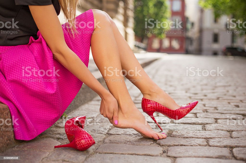 Woman with injured foot stock photo