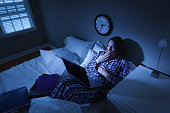 Woman with Insomnia, College Student in Bed Working on Computer