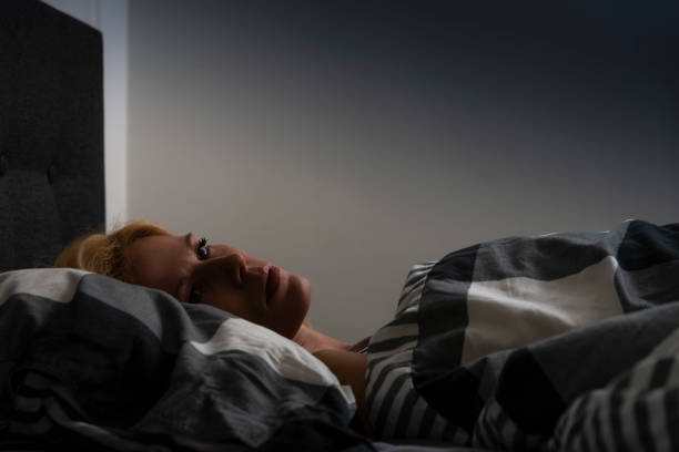 Woman with insomnia stock photo