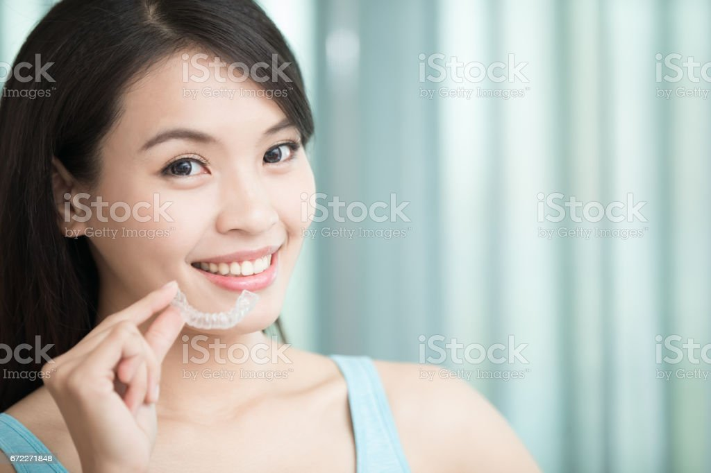 woman with invisible braces stock photo