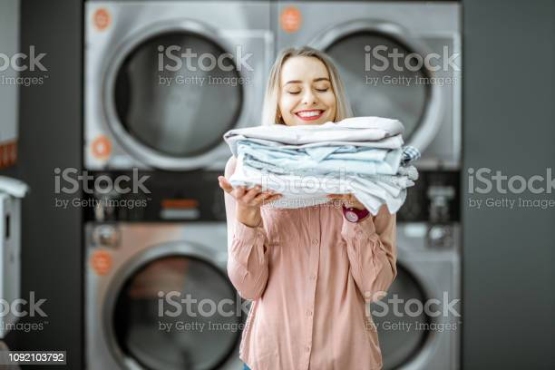 Woman with ironed clothes in the laundry picture id1092103792?b=1&k=6&m=1092103792&s=612x612&h=jn0zt3jzvsyi6wbbhb7nshx25yrtzn s1hwscz2whzu=