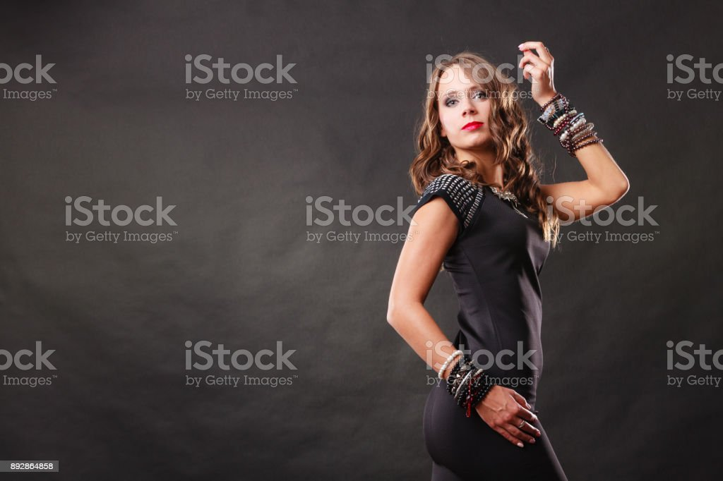 woman with jewellery in black evening dress stock photo