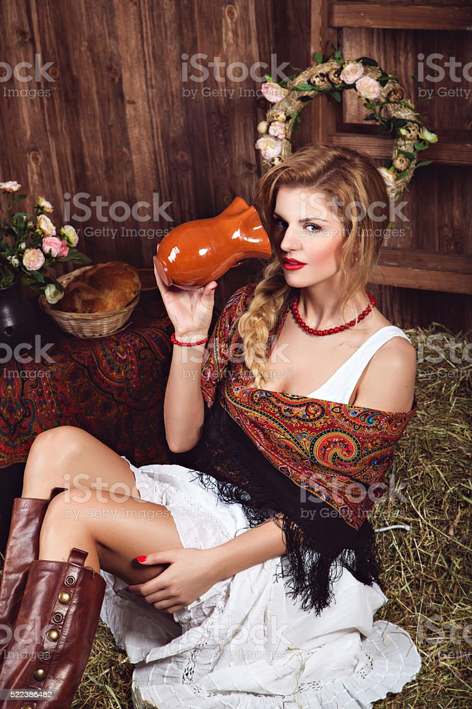 Woman with jug in rustic style stock photo