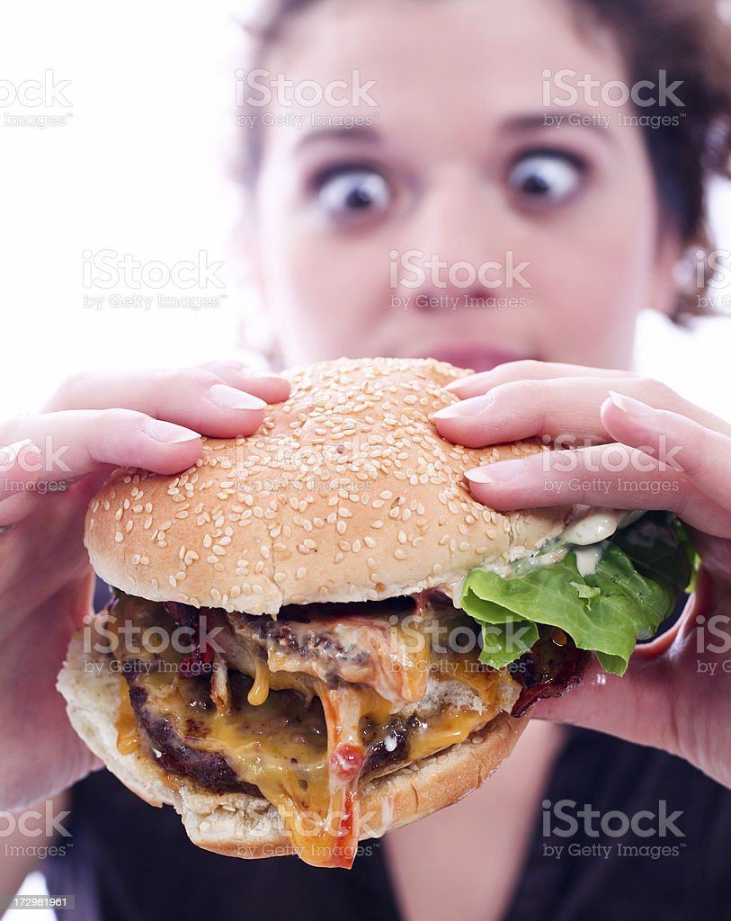 Woman with juicy burger stock photo