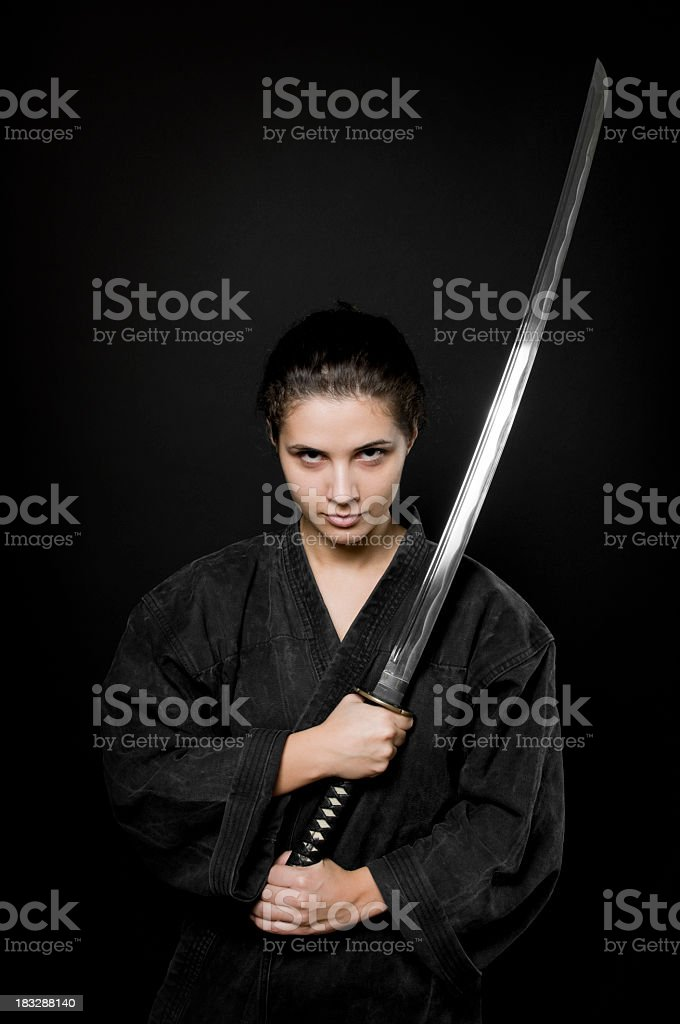 Woman with katana, black background royalty-free stock photo