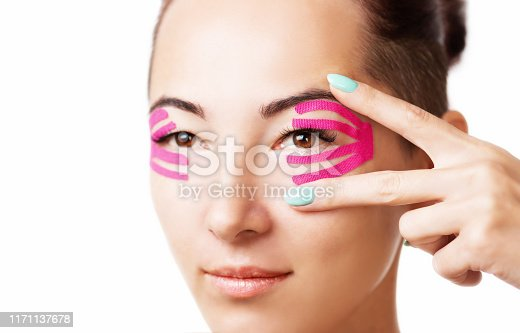 istock Woman with kinesiology tape on eyelid 1171137678