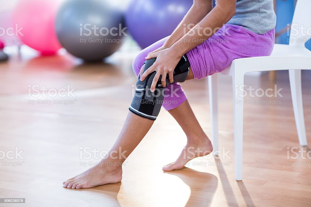 Woman with knee injury stock photo