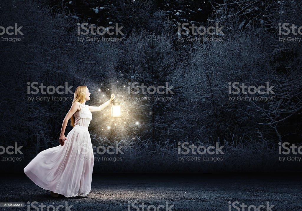 Woman with lantern stock photo