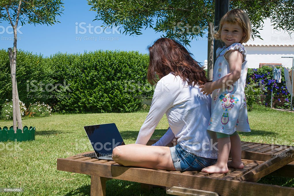 woman with laptop and little child at garden stock photo  sc 1 st  iStock & Top 60 Infant Beach Chair Stock Photos Pictures and Images - iStock