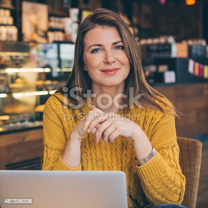 istock Woman with laptop at cafe. 487336206