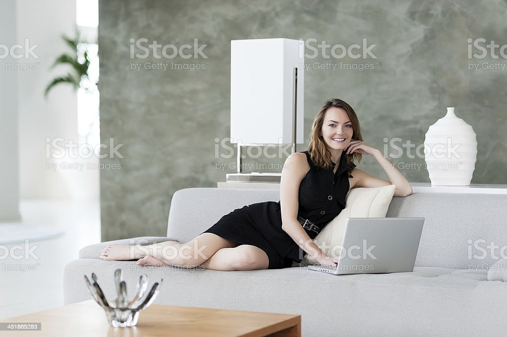 Woman with Laptop Computer in Model Home royalty-free stock photo