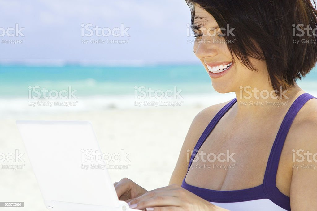 woman with laptop computer on the beach royalty-free stock photo