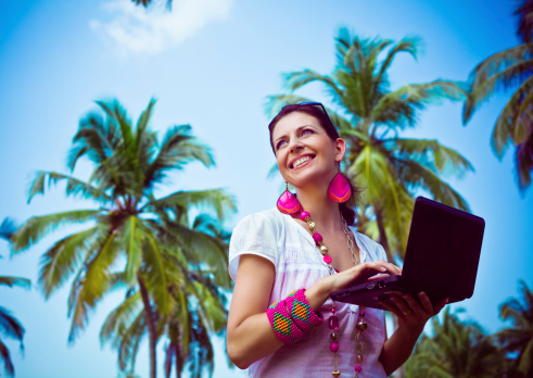 Woman With Laptop On Tropical Vacation Stock Photo - Download Image Now