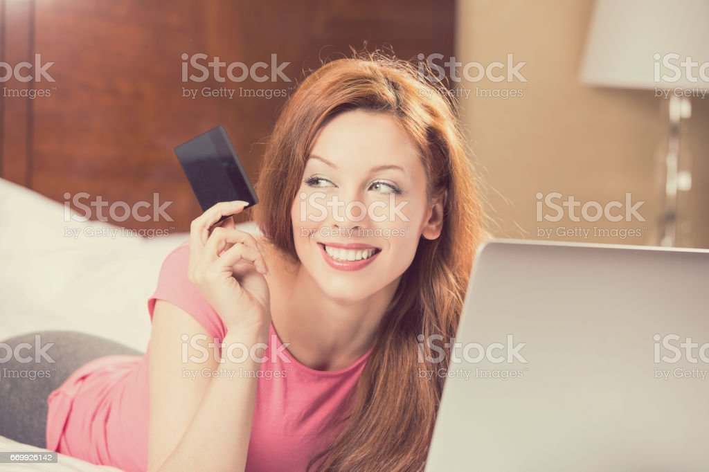 woman with laptop shopping on line holding showing credit card stock photo