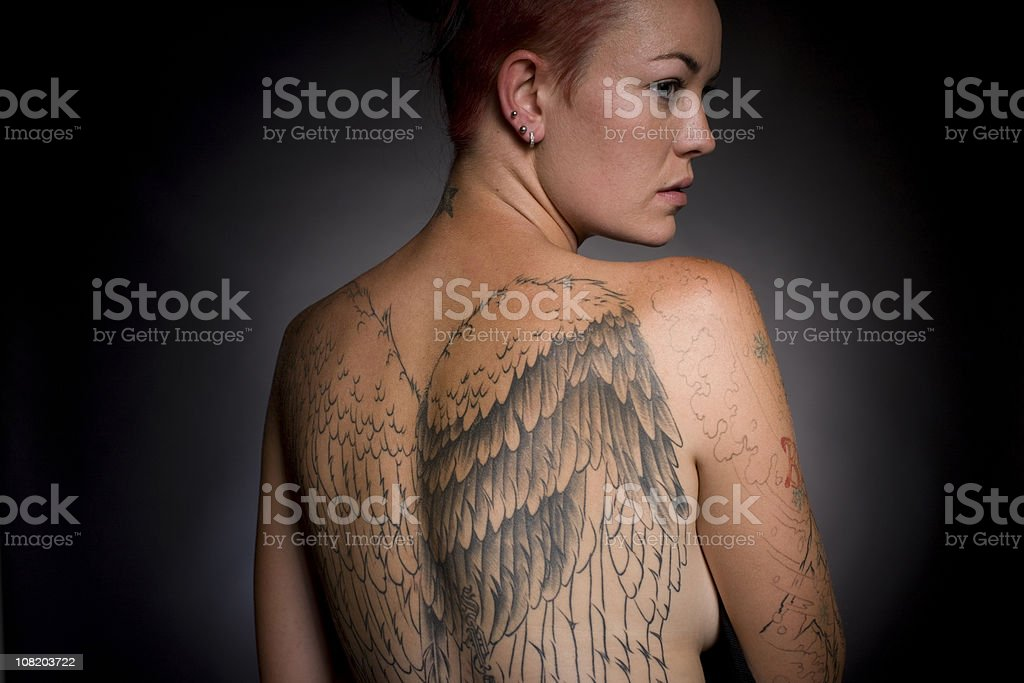 Woman with large Tattoo on her Back royalty-free stock photo
