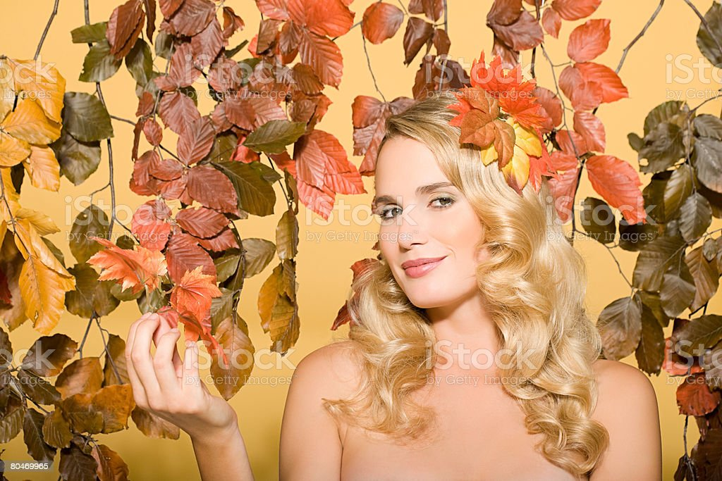 Woman with leaves 免版稅 stock photo