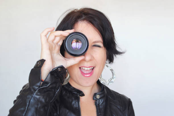 woman with lens stock photo