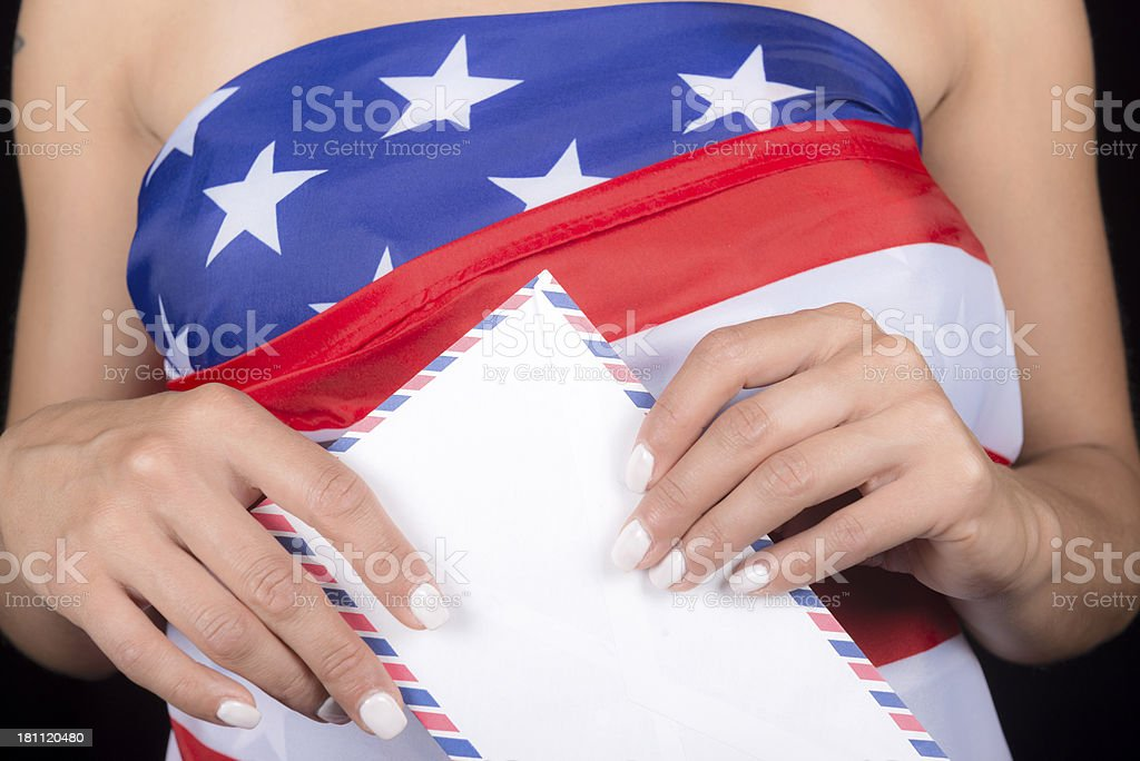 Woman with Letter and USA Flag royalty-free stock photo