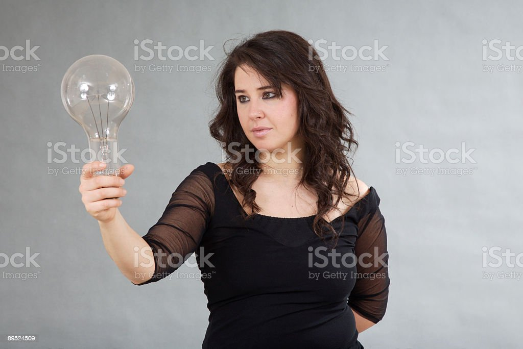 Woman with light bulb royalty-free stock photo