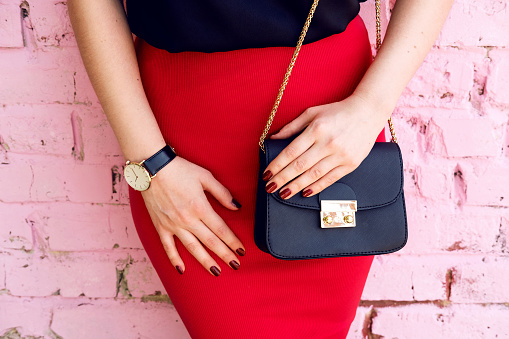 istock woman with little black bag in stylish outfit 621987934