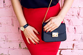 woman with little black bag in stylish outfit