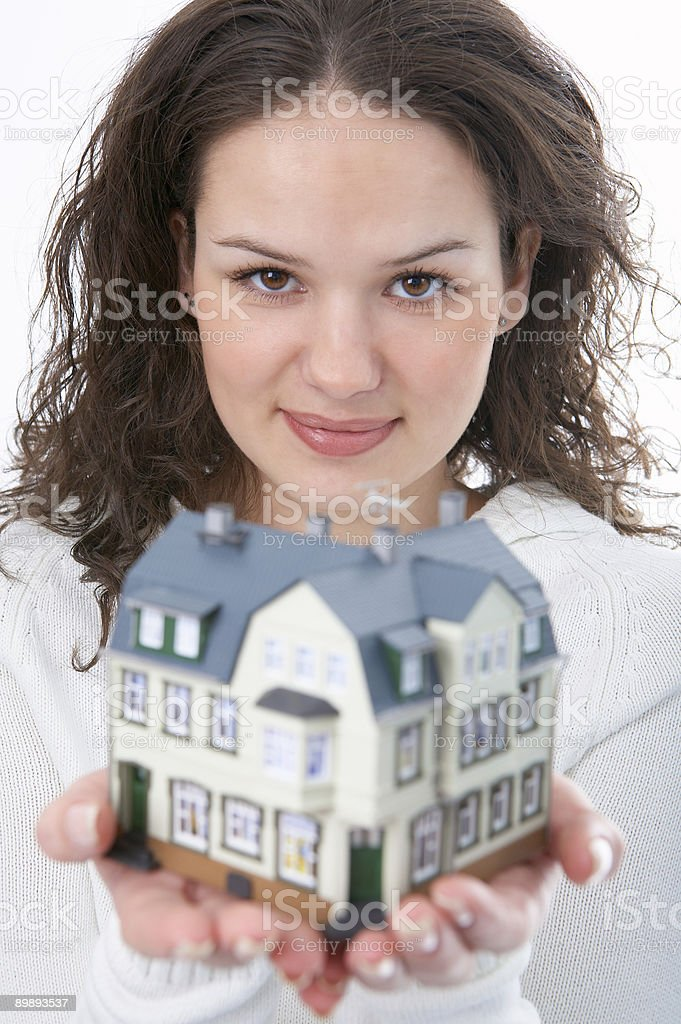 woman with little house in hand royalty-free stock photo