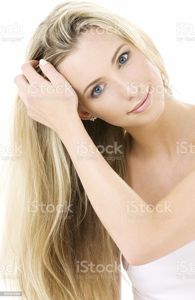 A woman with long beautiful blonde hair royalty-free stock photo