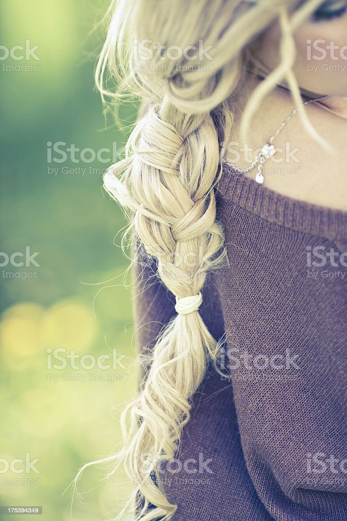 Woman with long braided hair stock photo