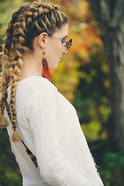 Woman with long braided hair Woman with long braided hair new age music stock pictures, royalty-free photos & images