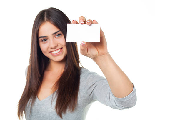 royalty free smiling young woman holding identification card sign