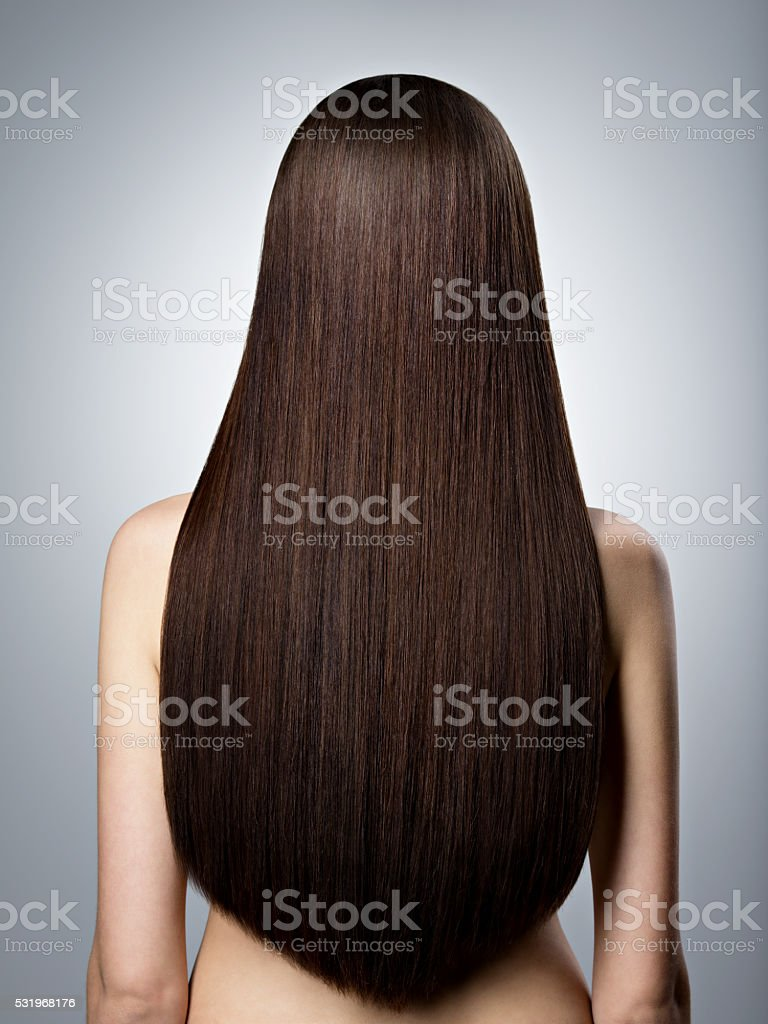 Woman with long brown straight  hair. Rear view stock photo