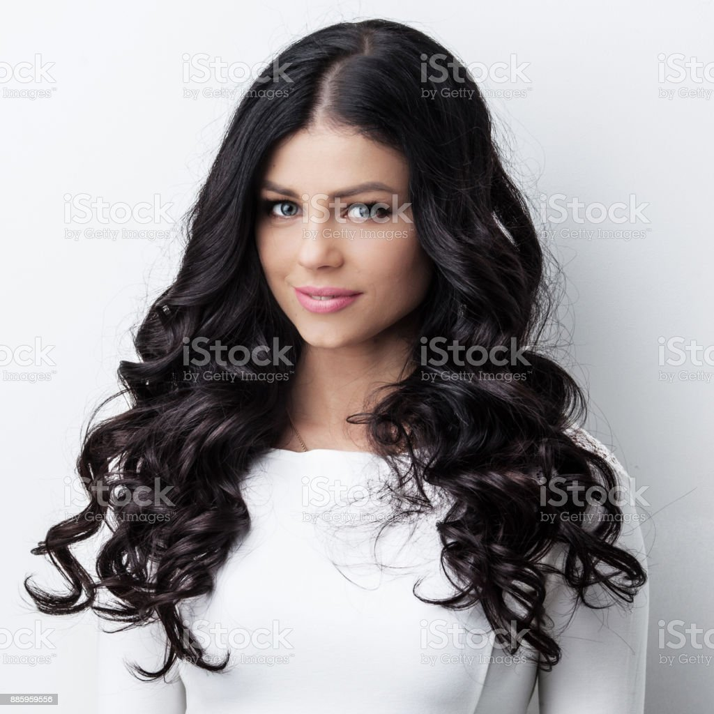Woman with long curly black hair stock photo