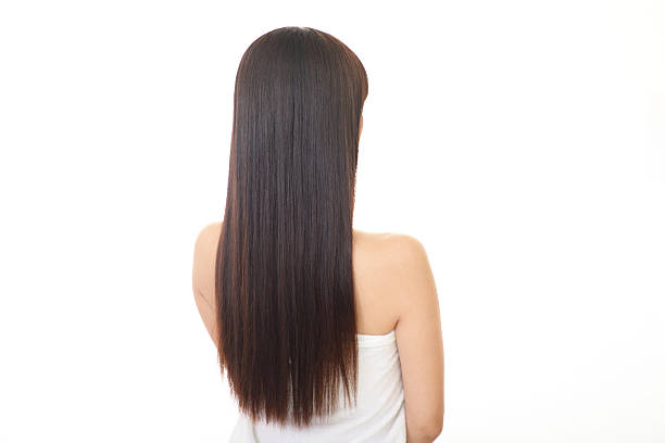Woman with long hair Young woman with beautiful long hair straight hair stock pictures, royalty-free photos & images