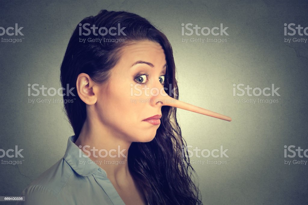 Woman with long nose isolated on grey wall background. Liar concept. Human face expressions, emotions, feelings'n stock photo