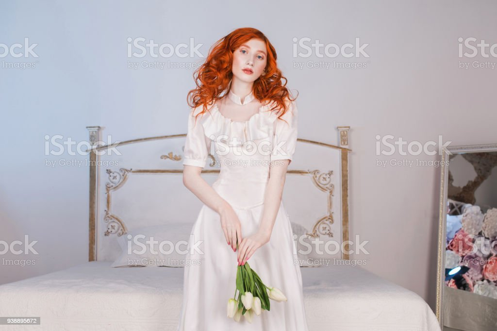 Woman With Long Red Curly Hair In White Vintage Wedding Dress With ...