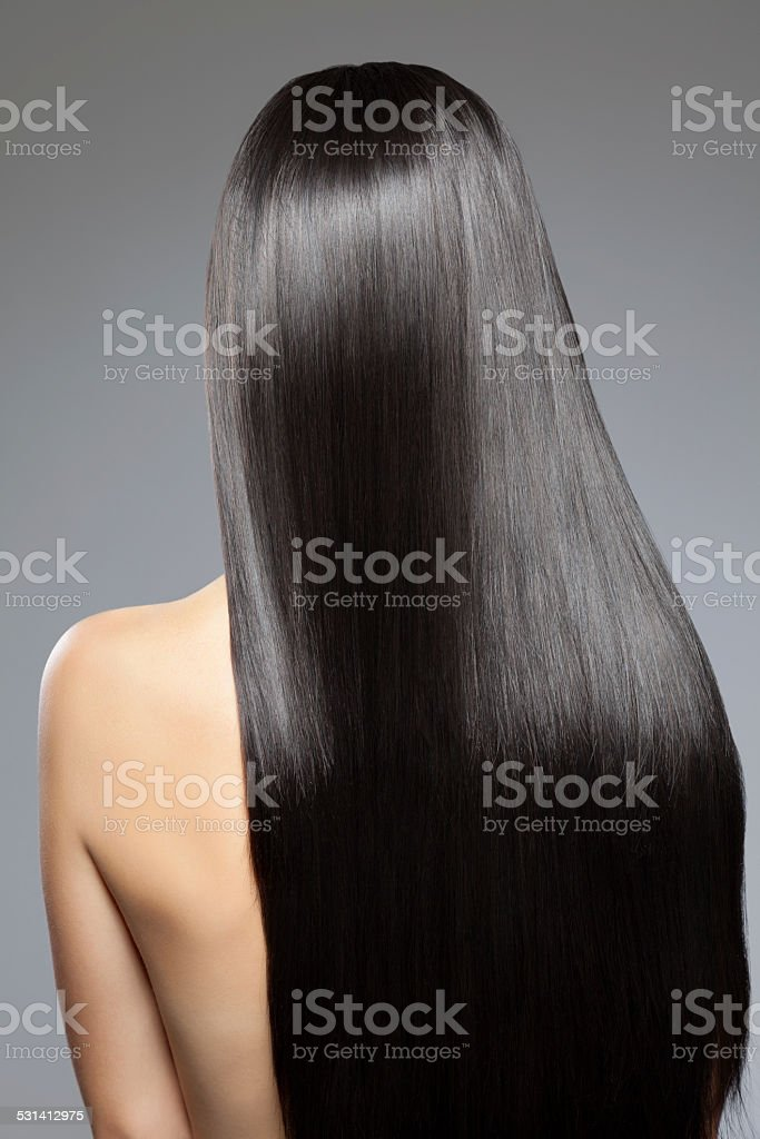 Woman with long straight shiny hair stock photo