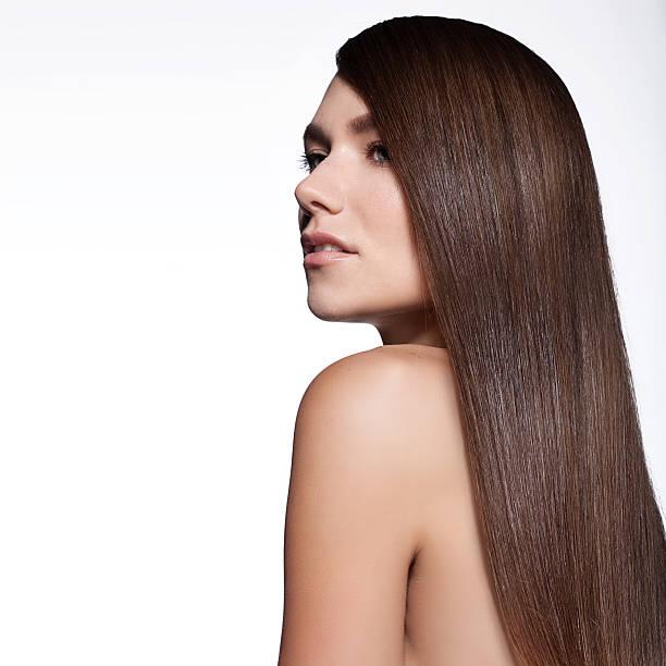woman with long thick straight hair - frisuren für schulterlanges haar stock-fotos und bilder