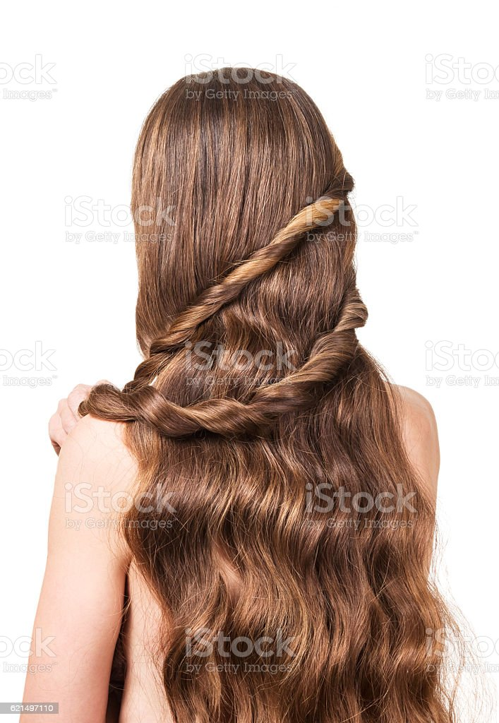 Woman with long wavy brown hair isolated on white background. photo libre de droits