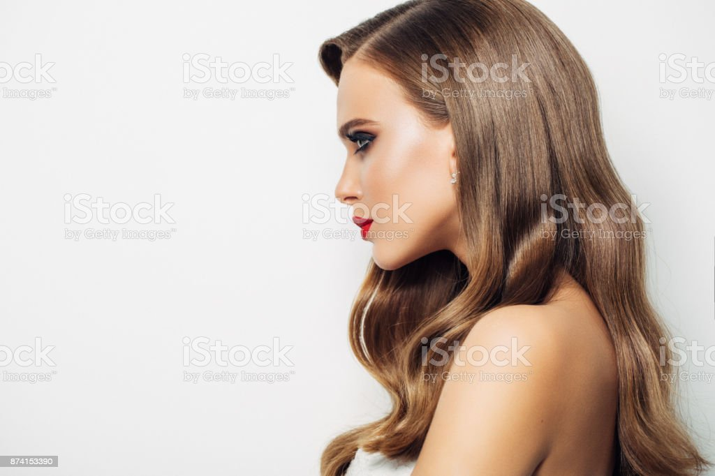 Woman with long wavy hairs stock photo