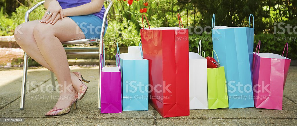 Woman with lots of shopping bags royalty-free stock photo