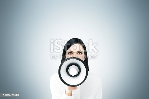 513123170 istock photo Woman with loudspeaker 515525930