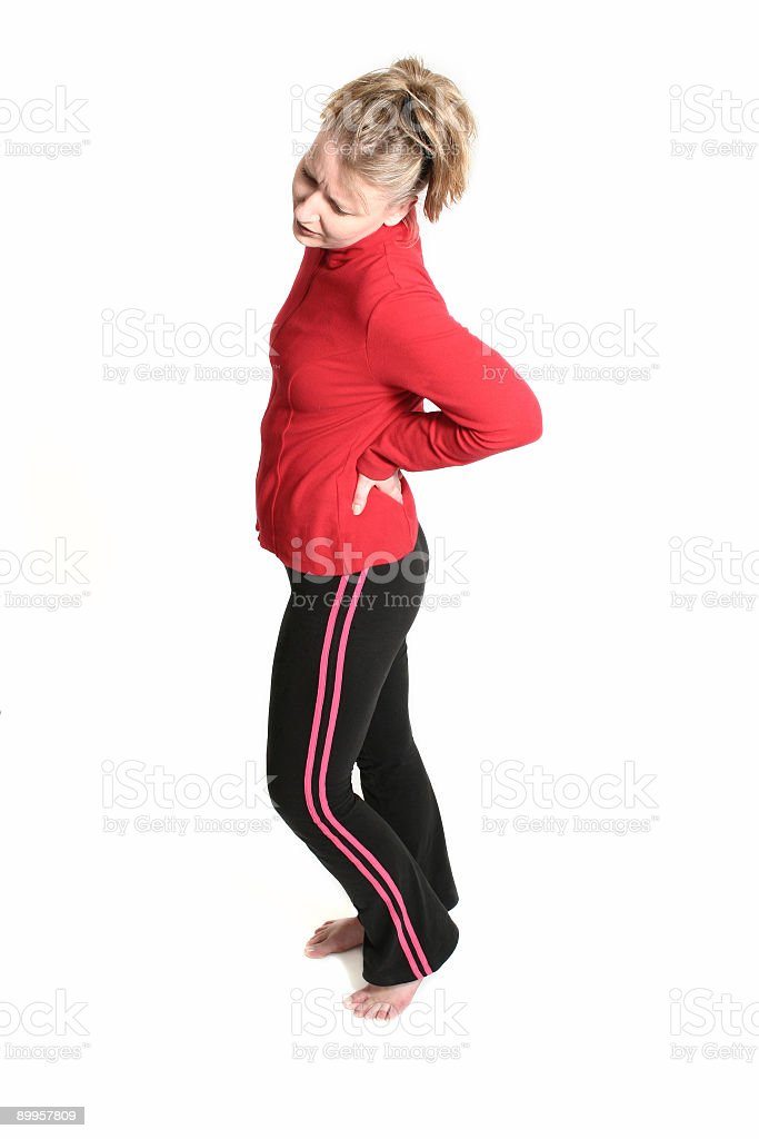woman with low back pain royalty-free stock photo