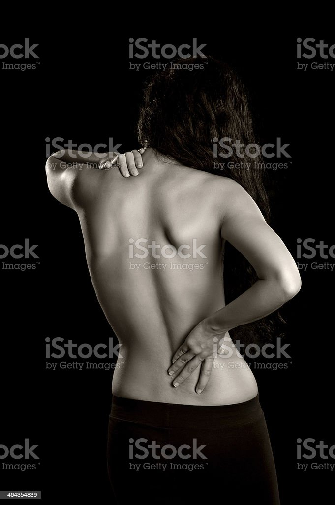 Woman with Lower Back and Shoulder Pain royalty-free stock photo