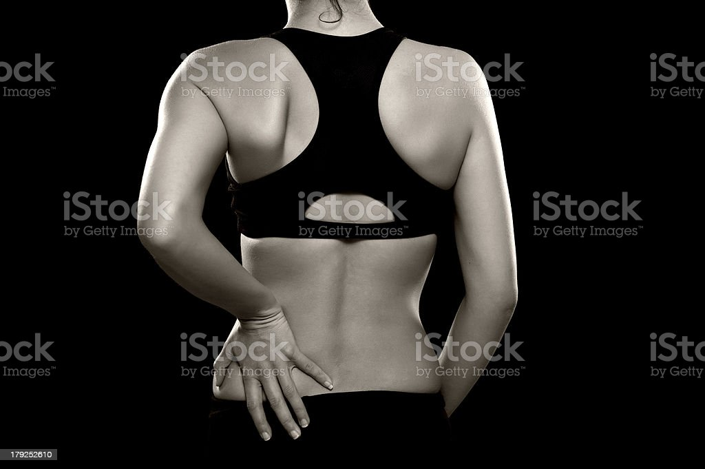 Woman with Lower Back Pain stock photo
