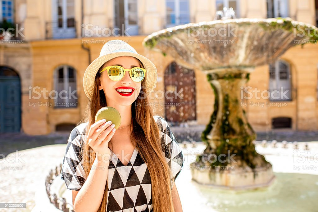 Woman with macaron in Provence city - Photo