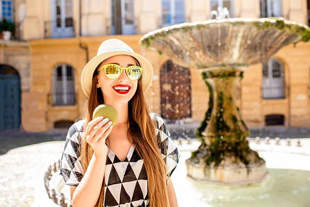 woman with macaron in provence city - aix en provence photos et images de collection
