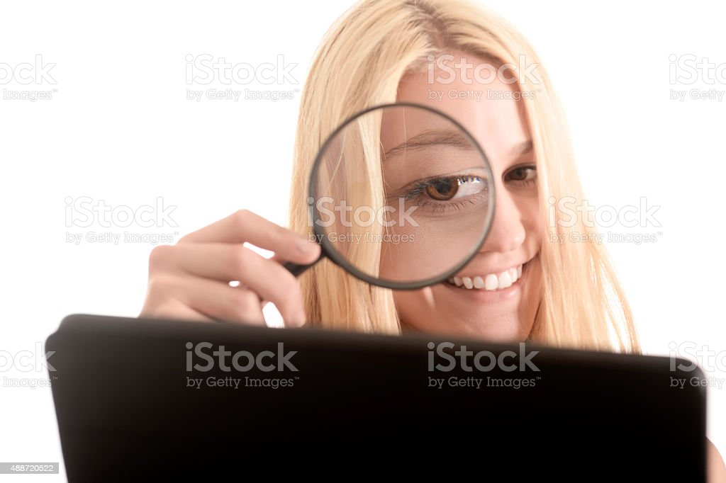 Woman with magnifier, digital tablet, error tracking stock photo