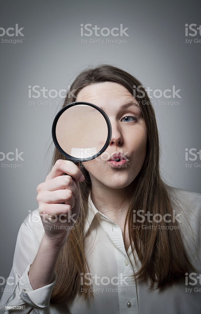 Woman with magnifier royalty-free stock photo